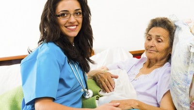 Female Nurse Caring for Elderly Patient